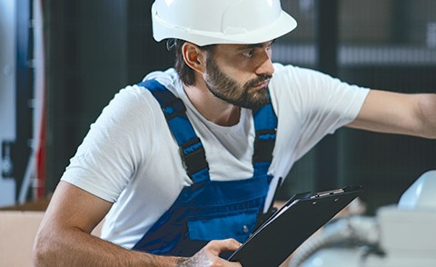 worker with hardhard and coveralls